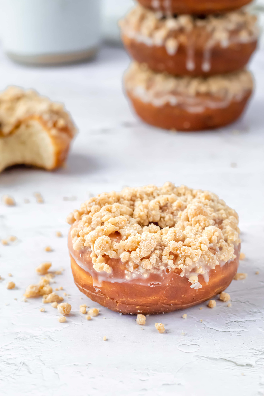 a close up of a crumb topped doughnut